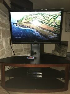 "42"" Insignia TV with mountable TV stand and swivel"