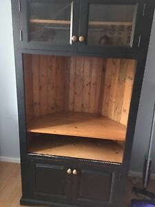 Corner solid wood entertainment centre. Moving need gone
