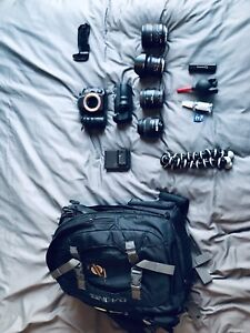 Sony a99 with 4 lenses battery pack and backpack