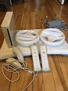 Wii + planche wii fit + jeux + accessoires