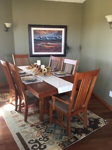 Mission style dining table with 6 chairs and 2 leafs