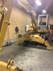 Mint 902 rubber tire excavator and brush head