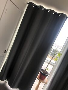 Grey curtains and rods