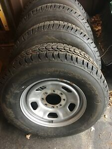 New snow tires on rims. Fit Ford F-250 or F350