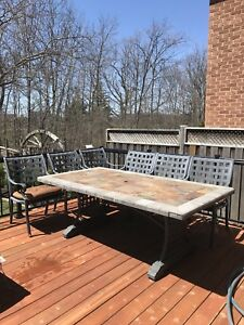 Stone outdoor table with 6 metal  chairs