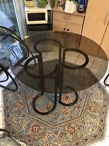 Round glass table, with 4 chairs