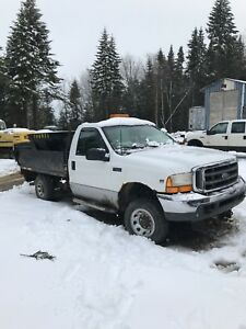 1999 F 250 - Plow truck with steel Flat Bed