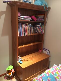 Solid timber bookcase with storage in great condition