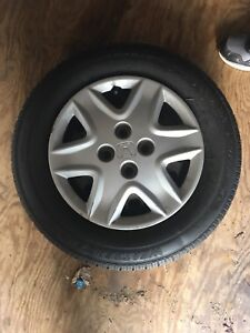 First $125 gets them :) 4 All season tires and Honda hubcaps