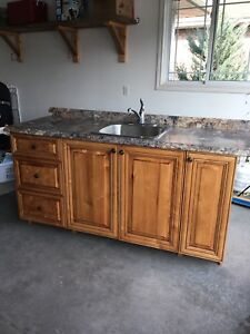 Wood cabinets, countertop, sink and faucet