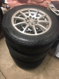 195/65 R15 Michelin tires on 5x100 rims