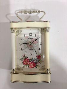 Antique style bedside clock.