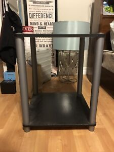 2 black and silver night stands