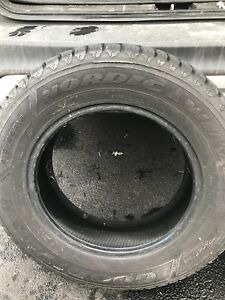2 Goodyear Nordic winter tires - used.