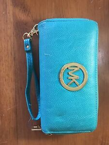 Blue wallet with Wristlet strap