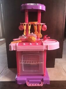 Pink play kitchen with lights and sounds