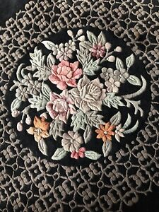 Black, white, and red floral area rug 2 m x 3 m