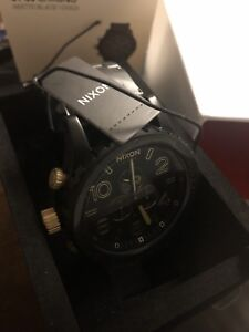 Nixon watch Matte Black / gold