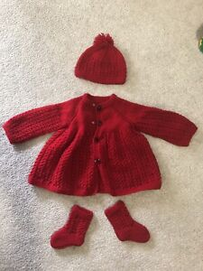 Handmade knit sweaters for baby girls. $7 each