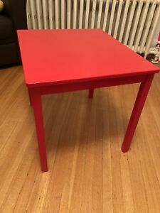 Red table and three chairs