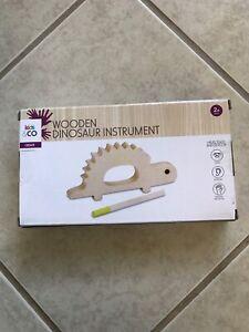 Wooden dinosaur instrument Oak Flats Shellharbour Area Preview