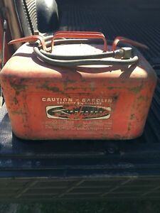 Five (5) old outboard gas tanks