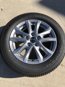 2018 Mazda 3 Aluminium rims and rubber! Literally brand new!