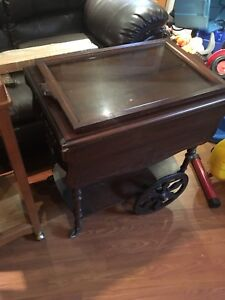 Wooden tea cart with glass serving tray