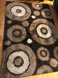 Two Super shaggy rugs brown colour