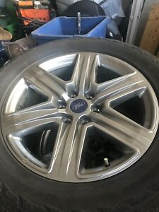2018 Ford F-150 Sport rims, and all terrain tire.