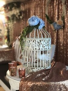 Assorted sizes birdcages with flowers wedding decor
