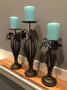 2 Iron heavy duty candle holders with new candles