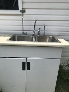 Double sink with faucet, soup dispenser, counter and cabnet