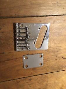 Bridge et neck plate