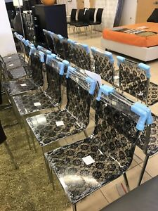 Commercial grade BLACK LACE EMBEDDED methacrylate chairs.
