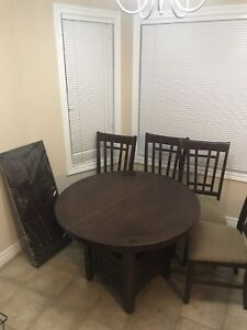 """Brown dark dining table 42"""" round extendable to 42""""x60"""""""