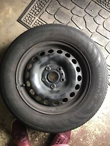"""15"""" steel rims and tires with vw hub caps"""
