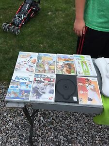 10 Wii games, wii fit board and accessories