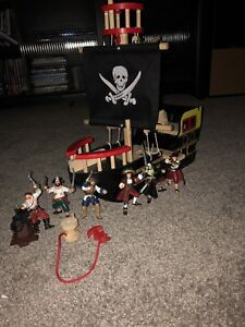 Toy pirate ship and figurines