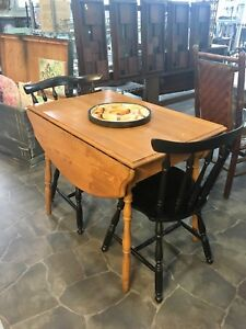 Apartment size antique oak drop leaf table $250 chairs $60 ea.