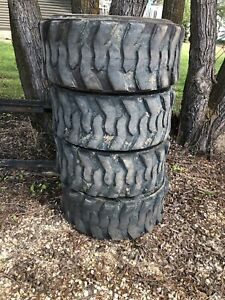 4 used 12x16.5 skidsteer tires