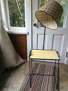 Mid century modern side table with 360 swivel light