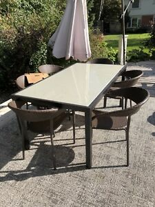 Smoked glass table top and 6 chairs