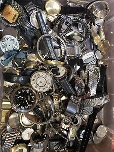 Tub full of vintage mechanical watches for pars or repair