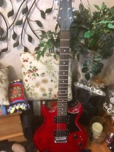 Ibanez Gio AX, older model with transparent red