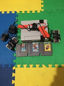 Nes with zapper and 3 games
