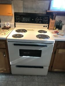 "30"" General Electric Stove."