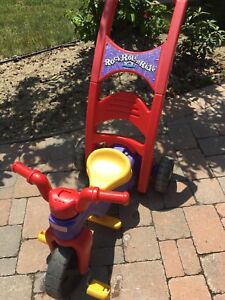 Tricycle by Fisher price.