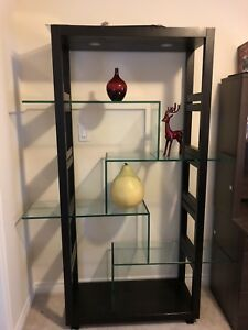 Glass and dark brown wood shelving unit
