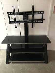 "Glass tv stand holds 47""+ TV"